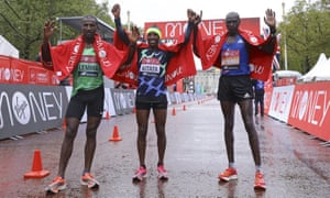 Ethiopia's Shura Kitata, center, celebrates after winning the London Marathon