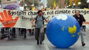 Protesters take part in the 'Climate March', one of many demonstrations during the conference