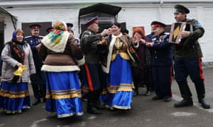 Members of a local Cossack community dance outside a polling station in Rostov-on-Don.