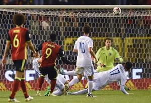 Romelu Lukaku scores with a deflected shot.