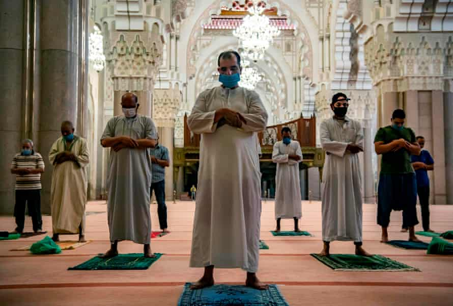 Muslim worshippers in Casablanca, Morocco, follow Covid restrictions during prayers at the Hasan II mosque, one of the largest in Africa.