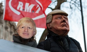 Demonstrators wearing masks of Donald Trump and Boris Johnson take part in a protest for keeping the National Health Service (NHS) publicly owned outside Downing Street in central London.
