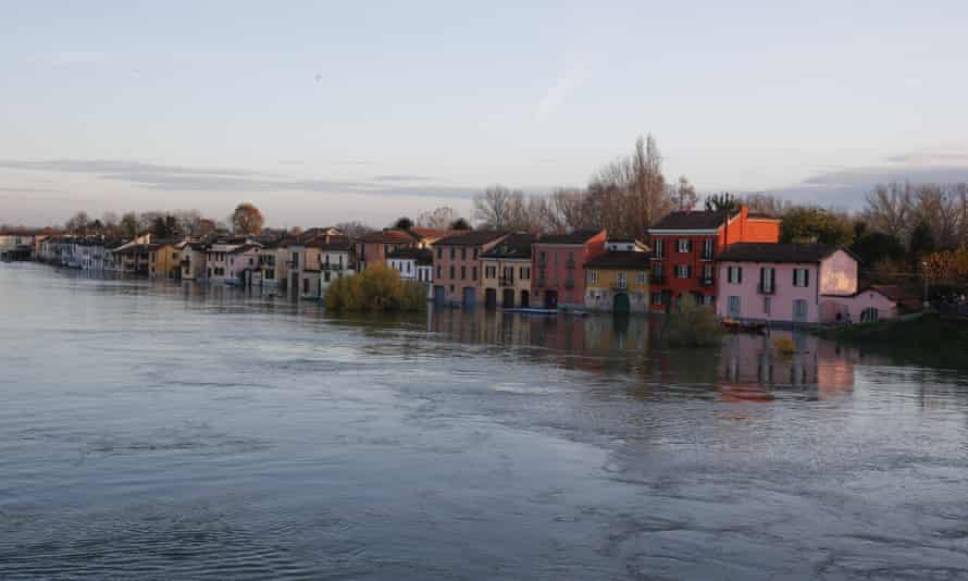 Water reaches the houses after the Ticino River overflowed its banks in Pavia, Italy.
