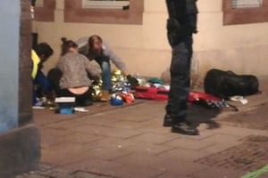 Picture taken with a mobile phone shows rescuers treating an injured person in the streets of Strasbourg.