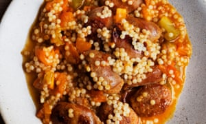 sausage and fregola with harissa on a round plate
