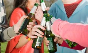 Teenagers with bottles of beer
