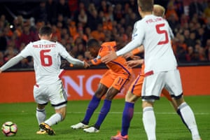 Quincy Promes scores the opener for Holland.
