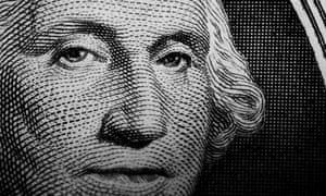 Close up detail of George Washington's portrait on the US one dollar note