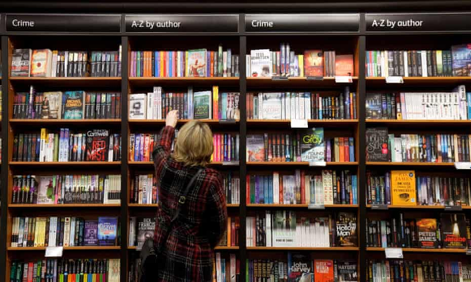A woman searches the shelves in a bookshop