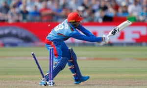 Afghanistan's Mujib Ur Rahman is bowled by Australia's Pat Cummins for 13.