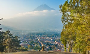 Cerro de la Cruz, Antigua Guatemala. At the north of Antigua is Cerro de la Cruz, there is a large cross constructed on a hillside overlooking Antigua. From this giant stone cross there are sweeping views south over the city with Agua Volcano in the background.
