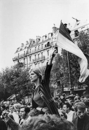 Demonstration in the Quartier Latin in Paris, 1968. Caroline de Bendern holds a Vietnamese flag on the Boulevard Saint-Michel.