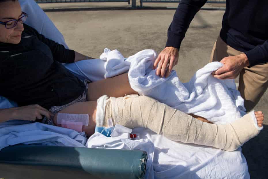 Mark Rapley unwraps the blanket around Chantelle Doyle's injured leg