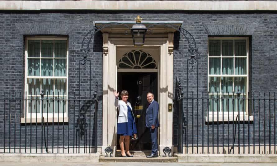 Democratic Unionist party leader Arlene Foster and DUP deputy leader Nigel Dodds arrive at 10 Downing Street.