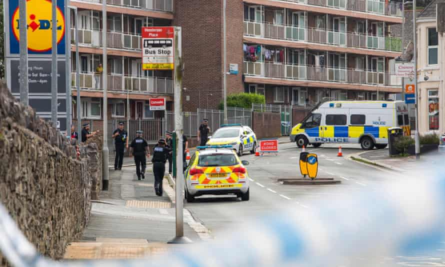 Police at Henderson Place, near the scene.