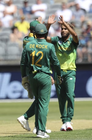 South Africa's Imran Tahir celebrates with teammates after taking the wicket of Australia's Mitchell Starc during their one-day international cricket match in Perth.