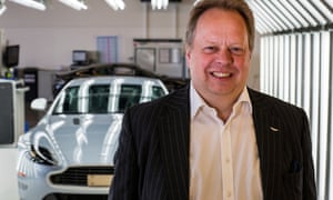 Andy Palmer,   Aston Martin boss, smiles at the camera in front of one of their cars
