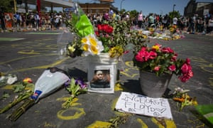 Flowers and written tributes are placed in the intersection of 38th Street and Chicago Avenue, the site where George Floyd died while in police custody.