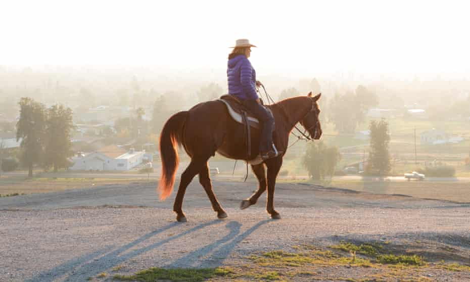A horse rider desends into the haze in Porterville –one of the most poluted cities in the US.