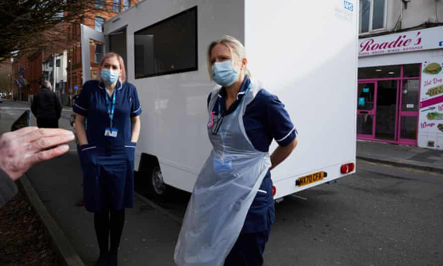 Homeless healthcare specialist nurses Helen Gee (left) and Liz Thomas giving Covid-19 vaccines to homeless people at their mobile clinic in Manchester.