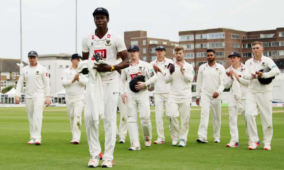Jofra Archer is applauded by his Sussex teammates after taking four wickets on his first-class debut in 2016.