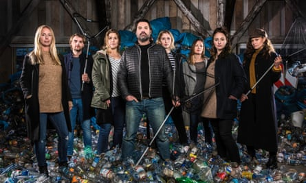 Marius Smit, centre, in a publicity image for Plastic Whale. He is surrounded by volunteers.