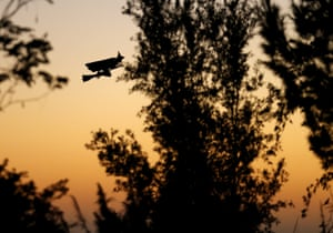 A remote control witch flies over a neighborhood as kids trick or treat below during in Encinitas, California.