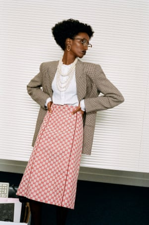 Blazer, £2,250, shirt, £990, skirt, £805, necklace, £1,610, and glasses, £290, by Gucci (gucci.com)  Earrings, £260, by All Blues (allblues.se)