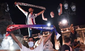 Lyon supporters celebrate on the streets of their home city after the away-goals elimination of Juventus in Turin on Friday