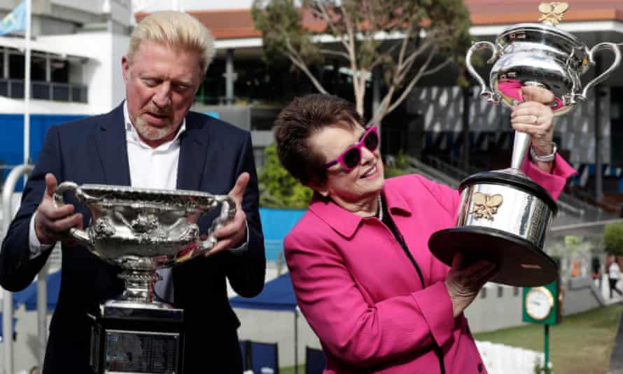 Boris Becker and Billie Jean King examine the trophies to be presented at the 2018 Australian Open.