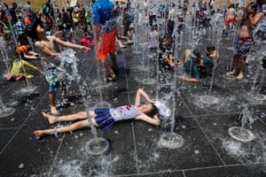 JerusalemYoung Israelis play in a water fountain on a hot day near the Tower of David near the Old City.