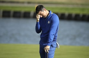 Rory McIlroy reacts to a missed putt on the 15th