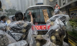 Supporters of anti-extradition protesters react to a police vehicle outside the Eastern magistrates court in Hong Kong.