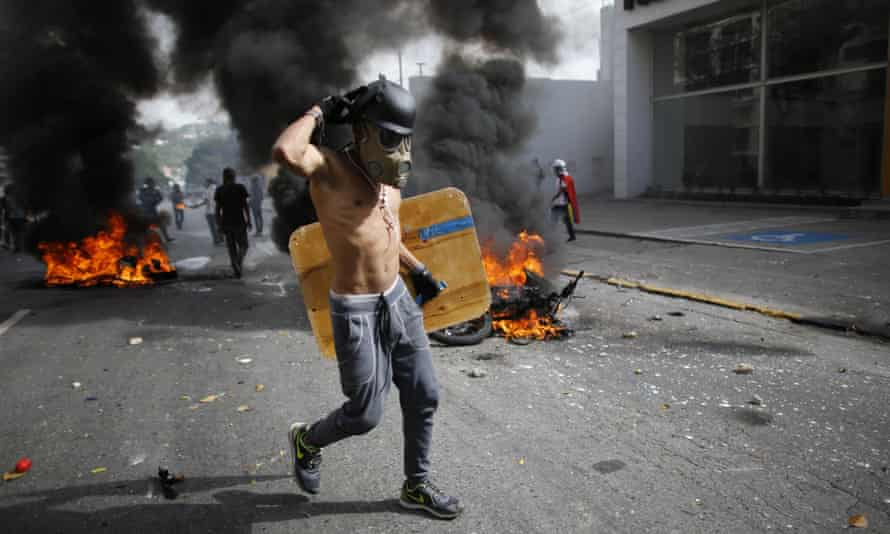 An anti-government demonstrator in Caracas, Venezuela. The country is entering its third month of protests.