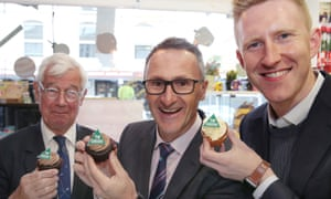 Greens candidate for Kooyong Julian Burnside, Richard Di Natale and the candidate for Higgins Jason Ball in Malvern, Melbourne on Thursday
