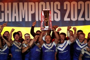 St Helens' James Roby lifts the trophy.