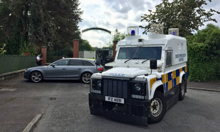 Police and army bomb disposal experts at Shandon Park golf club in Belfast, where the device was found.