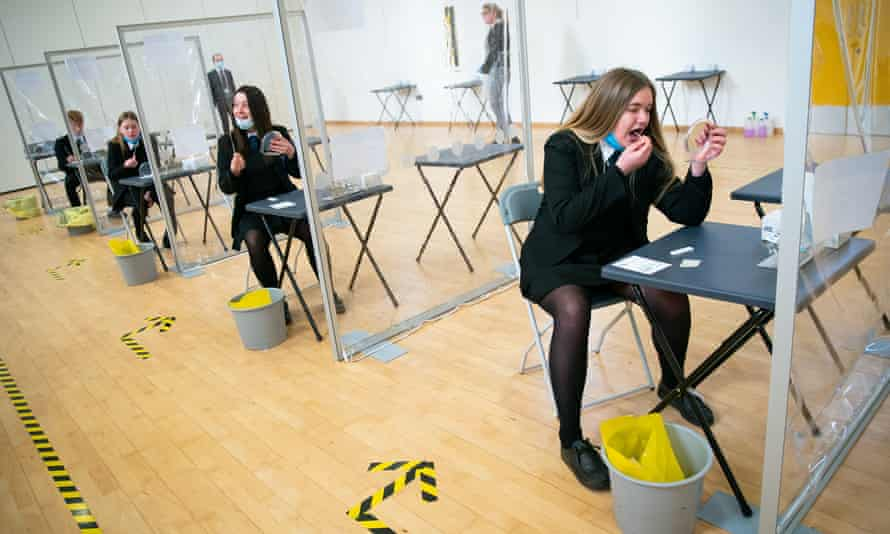 Students take a Covid-19 test in Coulsdon, Surrey.