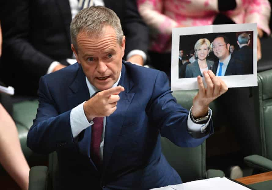 Bill Shorten holds a picture of Julie Bishop with Chinese businessman Huang Xiangmo in parliament this week.