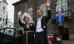 The president, Guðni Jóhannesson, and his wife, Eliza Reid, wave before his swearing-in ceremony in Reykjavik.