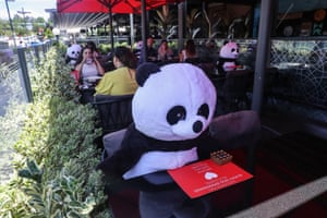 Toy pandas are placed at tables for social distancing in the Söğütözü district in Ankara, Turkey.