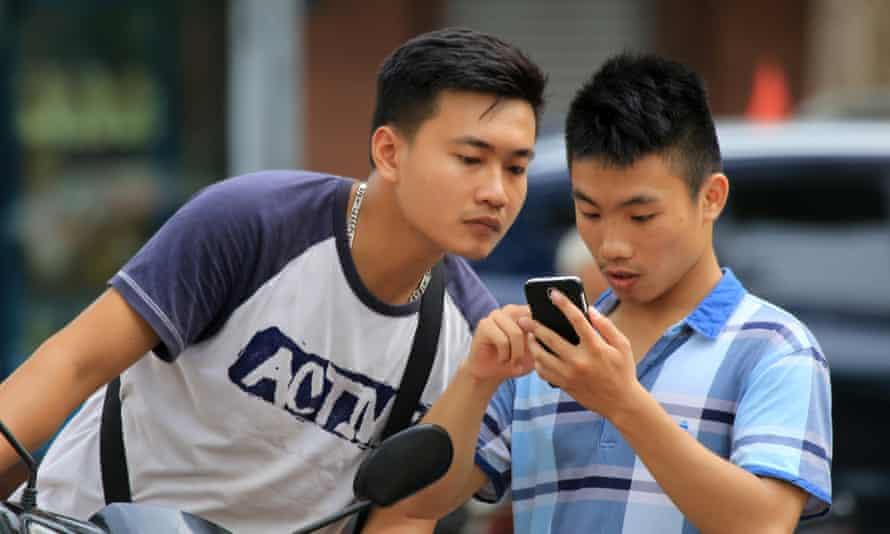 Two men play Pokémon Go in Hanoi, Vietnam.