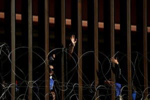 People wave from behind the border fence in El Paso, Texas, before a brief reunification meeting for relatives separated by deportation and immigration, as pictured from Ciudad Juárez in October 2019.