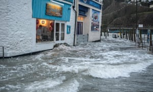 As sea levels rise, coastal towns such as Looe in Cornwall are increasingly prone to flooding.