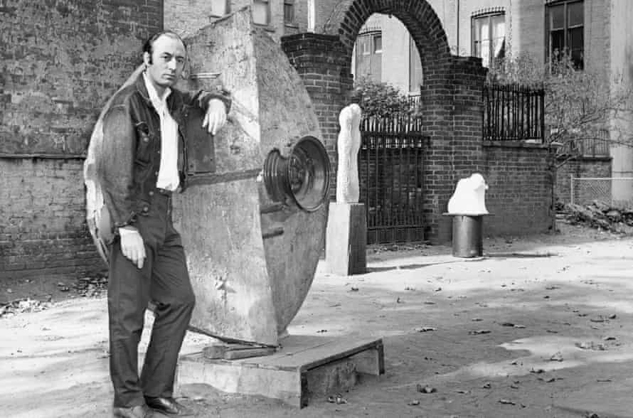 Tambellini leans against one of his sculptures in the churchyard of St Mark's church, New York, in 1963.