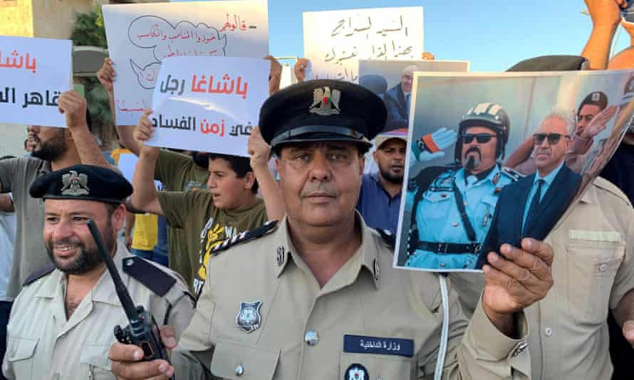 Police with posters supporting Bashagha