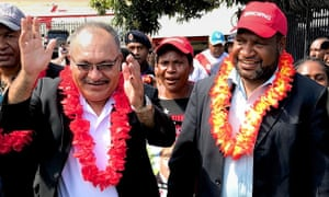 James Marape, right, says there will be a commission of inquiry into a $1.2bn loan borrowed by the government of his predecessor Peter O'Neill, left