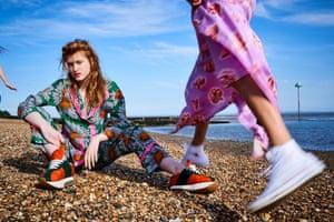 Lulu wears floral-print pyjama top, £1,370 and daisy pyjama trousers ,£795, both Gucci, brownsfashion.com Sneakers, £550, marni.com Pink satin dress, £1,995, Peter Pilotto  matchesfashion.com All Star hi-top trainers, £55, Converse schuh.co.uk