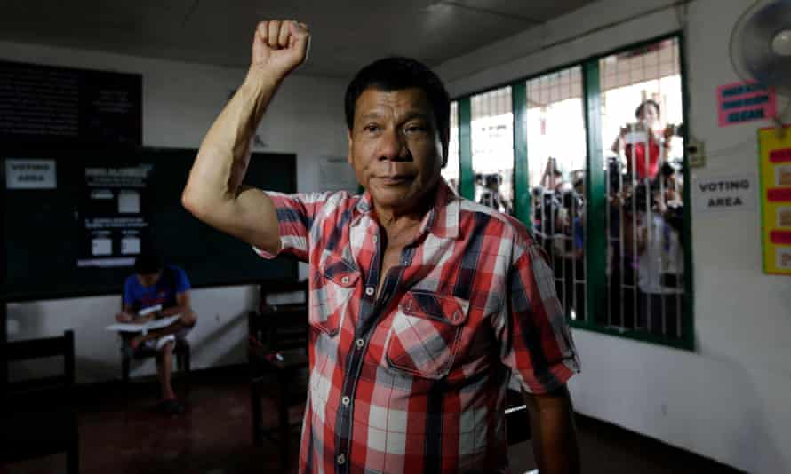 Filipino presidential candidate Rodrigo Duterte prepares to vote in Davao City.