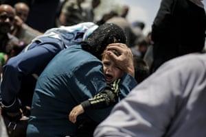 Mosul, Syria A child cries onboard a ferry